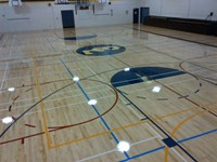 Coquitlam-middle sized gymnasium floor centre logo side courts pratice courts